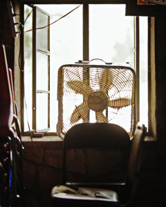 A fan in the window at the Devilsbackbone Tavern, Comal County, Texas, USA.
